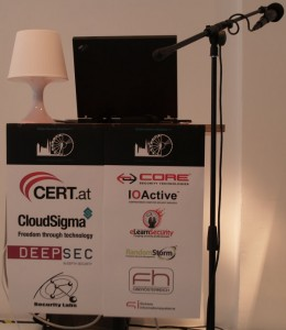 BSides Vienna / Ninjacon - Podium with lamp, laptop and microphone.