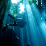 Diving in Cenote. Source: https://commons.wikimedia.org/wiki/File:Cenote_por_Gustavo_Gerdel.jpg